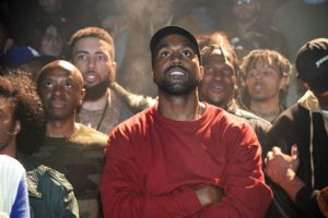 Kanye West looks on during yesterday's show. PHOTO CREDIT: Kevin Mazur/Getty Images