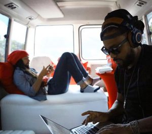 Machel and Kees being transported on the Digicel bus in Jamaica.