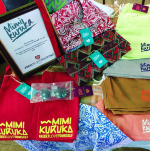 Mimi Kuruka is available in hats, totes, t-shirts, tank tops, shorts, wristlets, and dashiki styled tops.